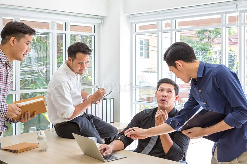 Meeting consultant for financial. Group businessman planning data at meeting. Business people meeting around desk. stock image