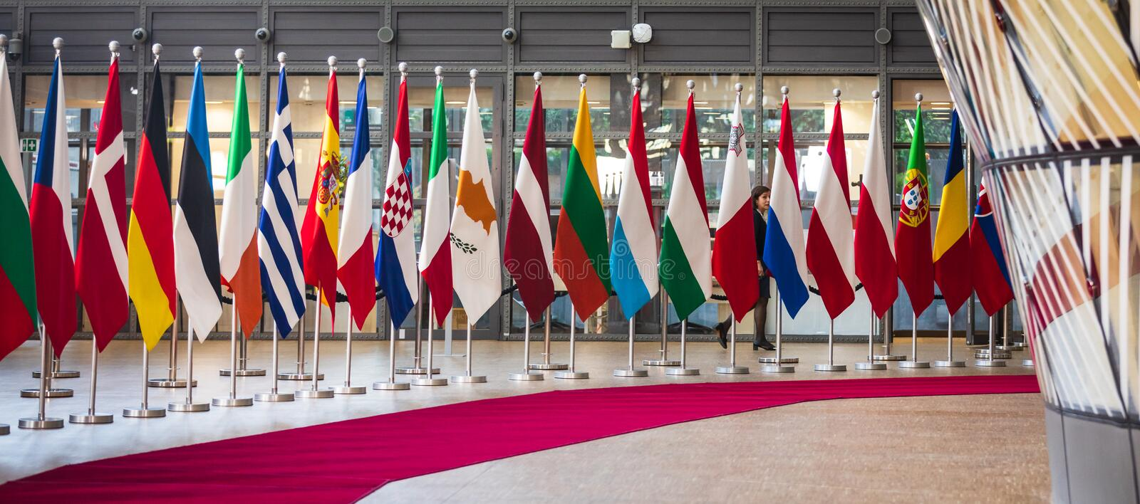 Meeting of EU leaders at the EU headquarters. BRUSSELS, BELGIUM - May 13, 2019: Flags on the meeting of EU leaders at the EU headquarters. High Level Conference royalty free stock images