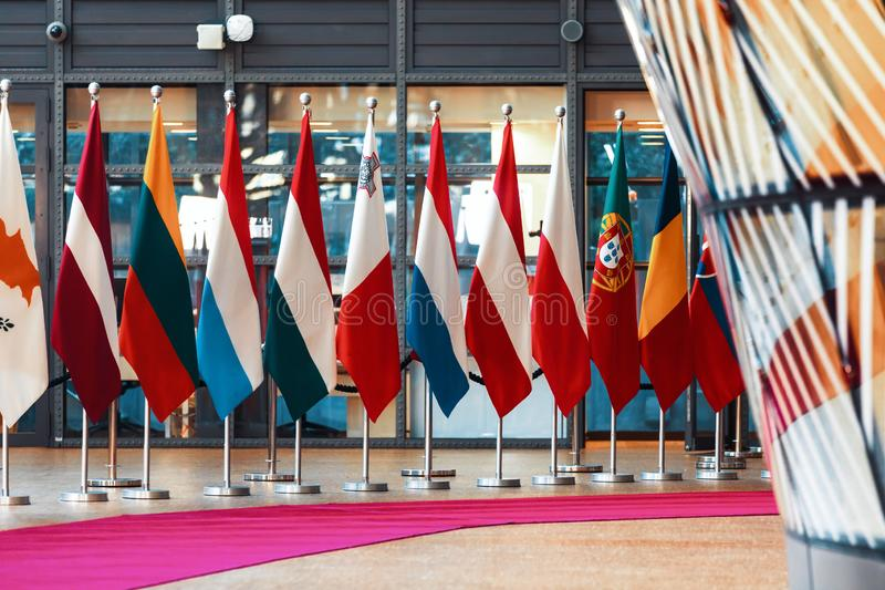 Meeting of EU leaders at the EU headquarters. BRUSSELS, BELGIUM - May 13, 2019: Flags on the meeting of EU leaders at the EU headquarters. High Level Conference stock images