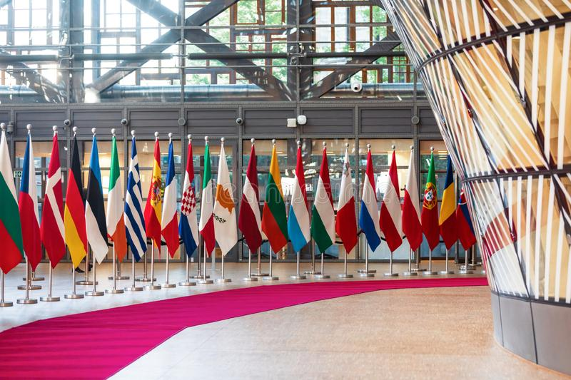 Meeting of EU leaders at the EU headquarters. BRUSSELS, BELGIUM - May 13, 2019: Flags on the meeting of EU leaders at the EU headquarters. High Level Conference stock image