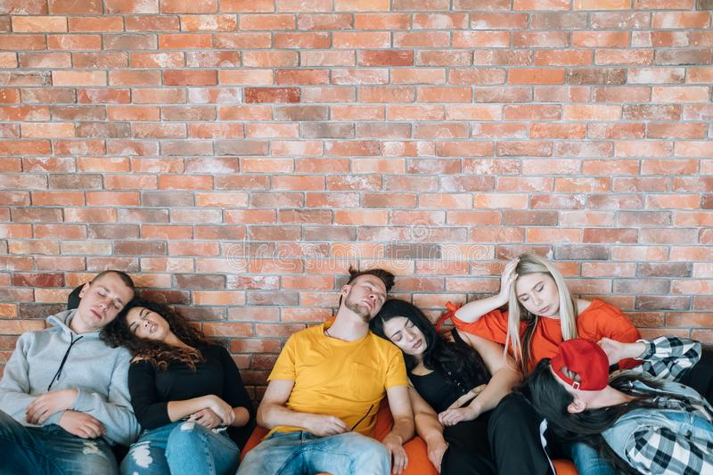 Meeting exhaustion tired team millennial culture. Productive meeting. Exhaustion. Tired business team sleeping on bean bags. Millennial culture. Creativity and stock image