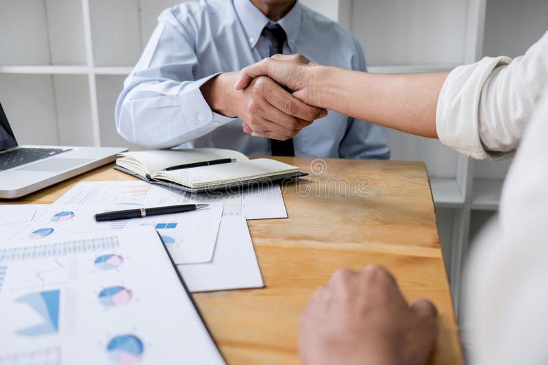 Meeting and greeting concept, Two collaboration business handshake and business people after discussing good deal of contract and stock image