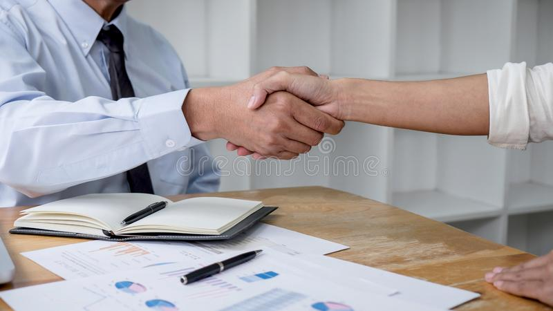 Meeting and greeting concept, Two collaboration business handshake and business people after discussing good deal of contract and stock photography