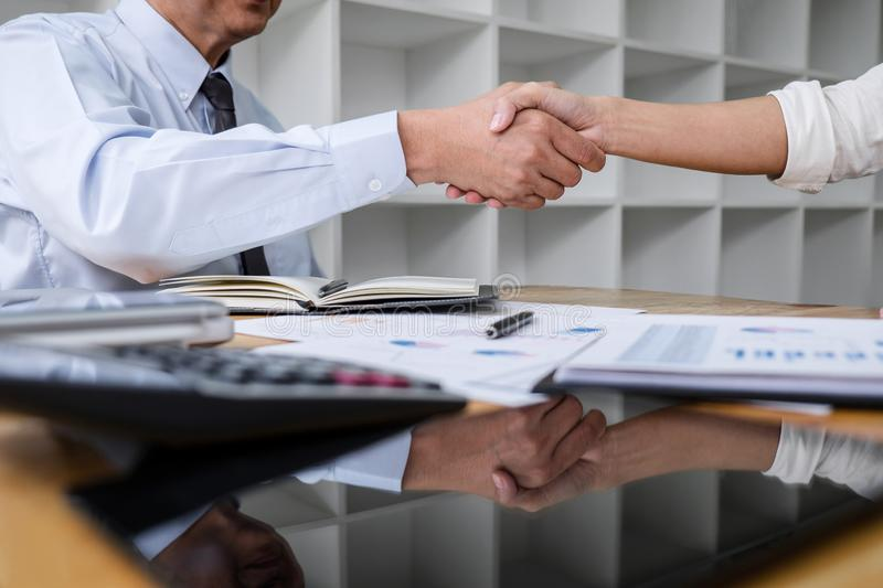 Meeting and greeting concept, Two collaboration business handshake and business people after discussing good deal of contract and royalty free stock photography