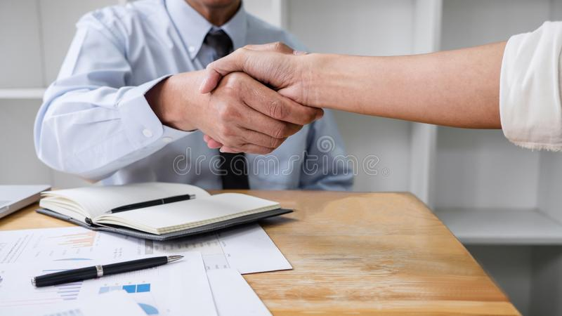 Meeting and greeting concept, Two collaboration business handshake and business people after discussing good deal of contract and royalty free stock photo