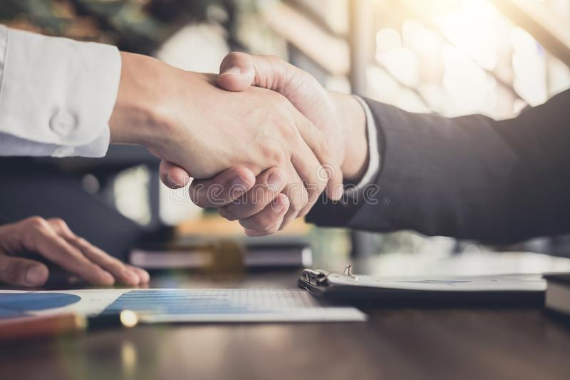 Meeting and greeting concept, Two confident Business handshake a. Nd business people after discussing good deal of Trading contract and new projects for both royalty free stock photos