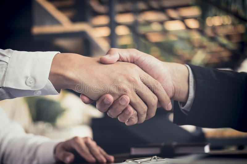 Meeting and greeting concept, Two confident Business handshake a. Nd business people after discussing good deal of Trading contract and new projects for both stock image