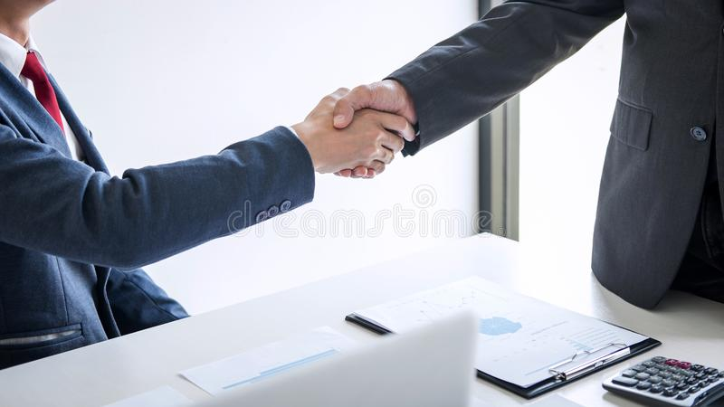 Meeting and greeting concept, Two confident Business handshake and business people after discussing good deal of Trading contract royalty free stock images