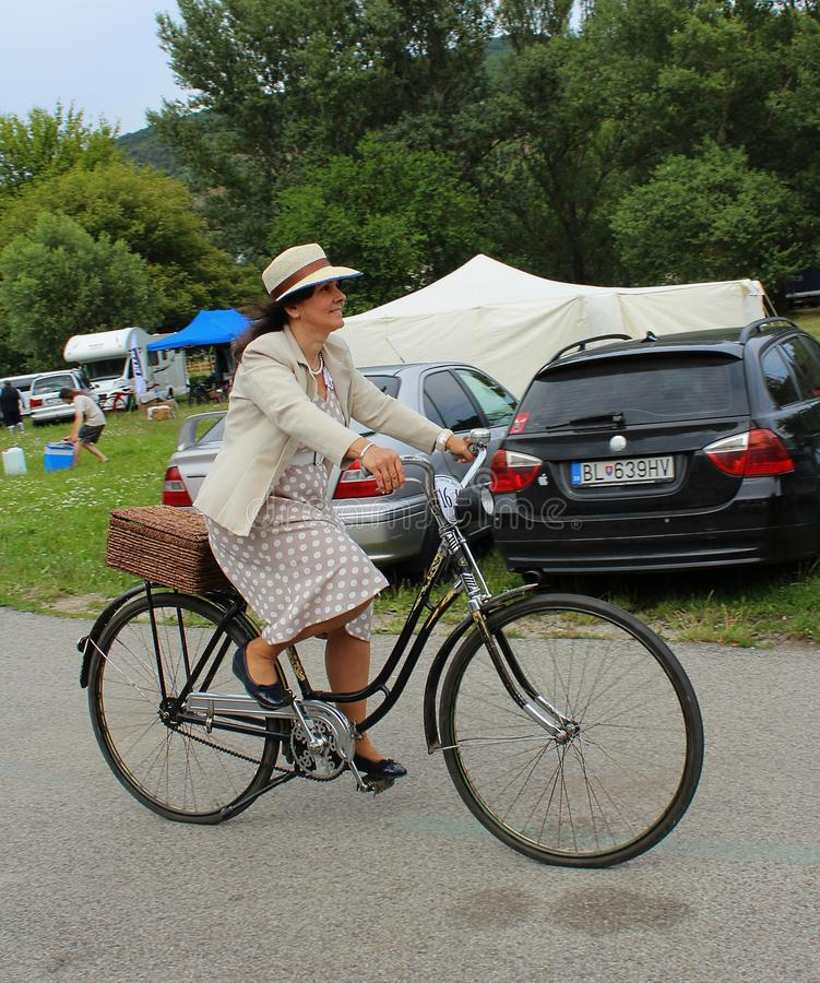 Meeting of Historical Bicycles - a lady in a vintage costume with corresponding bike royalty free stock photography