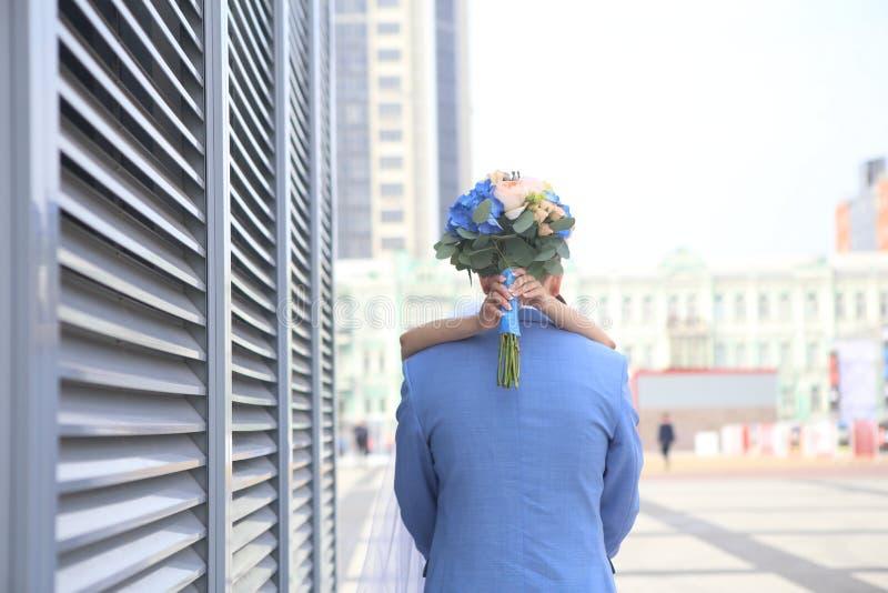 Meeting hugging bride groom outside bunch flowers royalty free stock photo