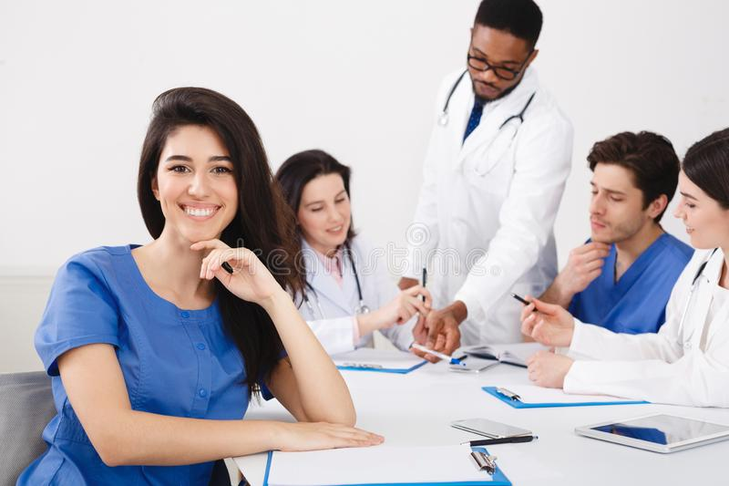 Meeting Of Medical Pros. Nurse Smiling To Camera At Meeting stock photo