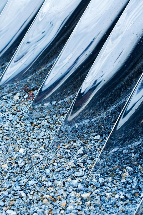 Meeting of metal and stone. Photo with metal constructions and stone, cold abstraction royalty free stock photography