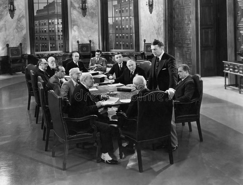 MEETING OF THE MINDS. (All persons depicted are no longer living and no estate exists. Supplier grants that there will be no model release issues royalty free stock photo
