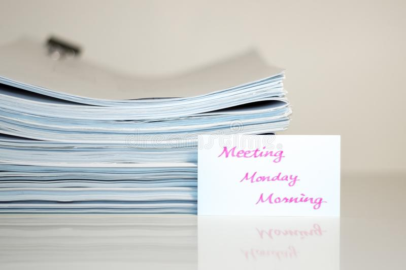 Meeting Monday Morning; Stack of Documents on white desk and Background.  stock image