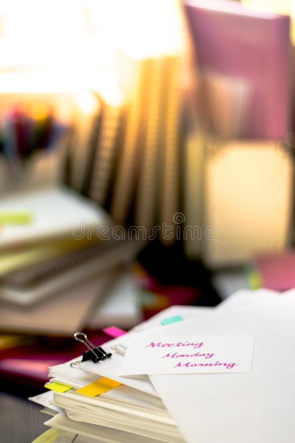 Meeting Monday Morning; Stack of Documents. Working or Studying. At messy desk royalty free stock photo