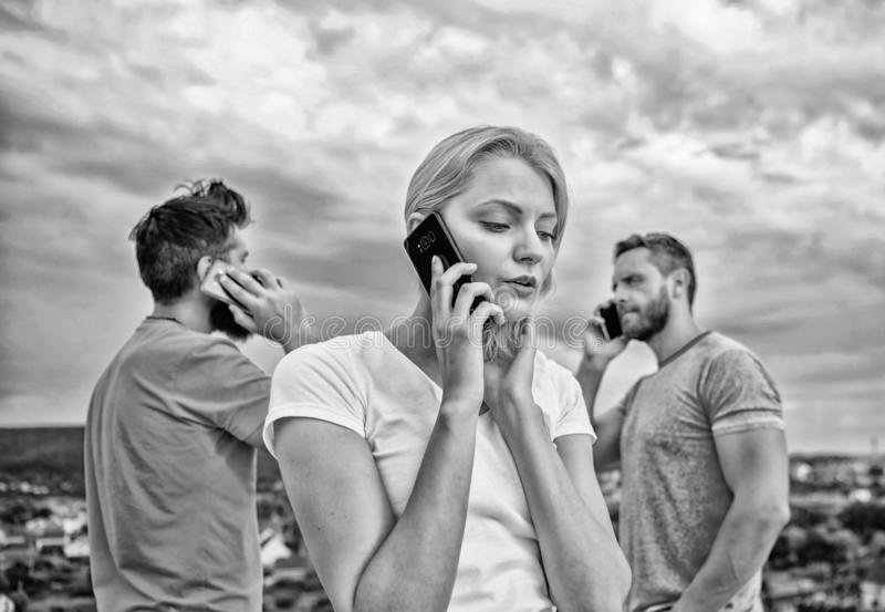 Meeting the need for communication. Modern people with smartphones outdoor. Group of friends talking on cell phones royalty free stock images