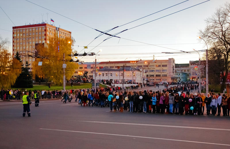 Meeting of the Olympic flame in the city of Ivanovo, evening October 17, 2013. IVANOVO, RUSSIA - OCTOBER, 17. Administration forces students to meet the Olympic royalty free stock photos