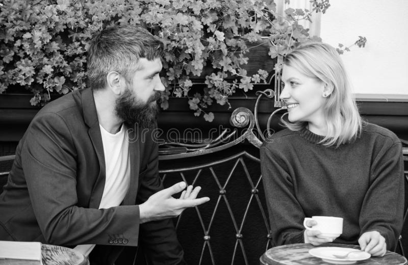 Meeting people first date. Couple terrace drinking coffee. Casual meet acquaintance public place. Romantic couple. Normal way to meet and connect with other stock photo