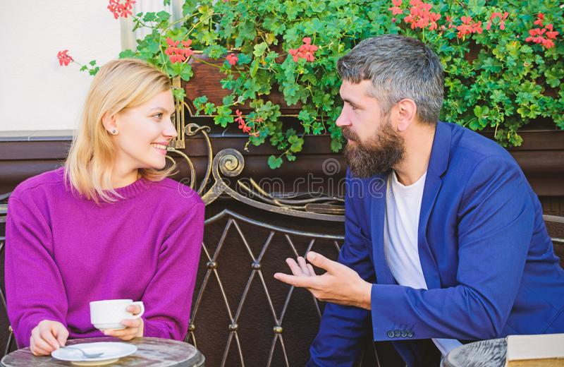 Meeting people first date. Couple terrace drinking coffee. Casual meet acquaintance public place. Romantic couple. Normal way to meet and connect with other stock photography