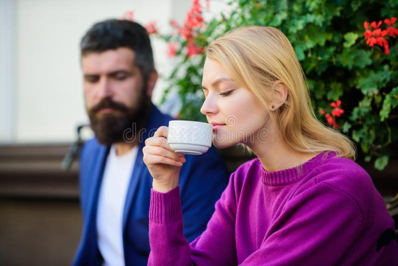 Meeting people first date. Strangers meet become acquaintances. Apps normal way to meet and connect with other single. People. Couple terrace drinking coffee royalty free stock photography