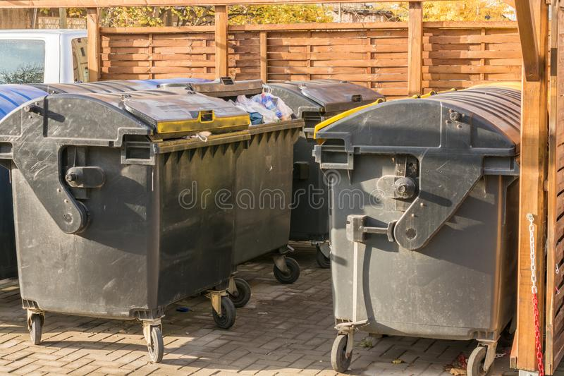 Meeting point for various garbage cans stock photos