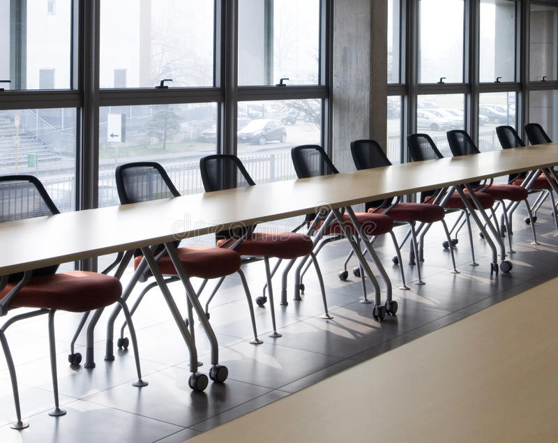Meeting room. With a long table near the window stock photos