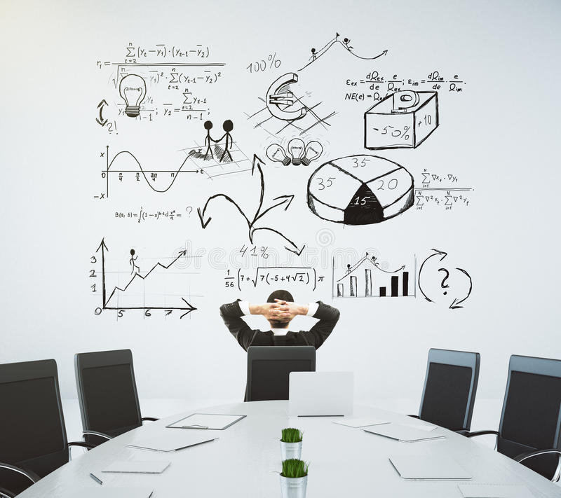 Meeting room with table and chairs and a business diagram on the. Wall stock images