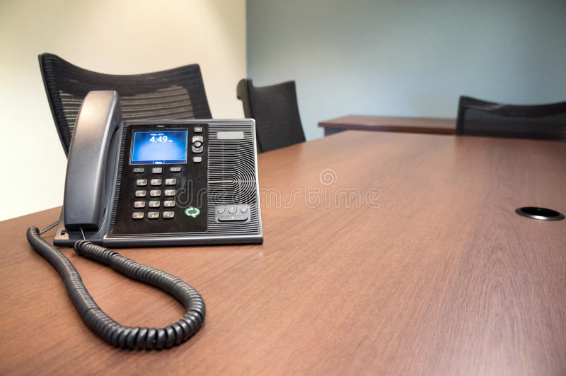 Meeting Room Telephone. Typical meeting room with telephone with more focus on the telephone stock image