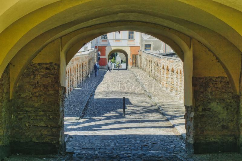 Solar and shaded side of the corridor side. Meeting in the shade and sun, walking in the historic buildings of the monastery royalty free stock photography