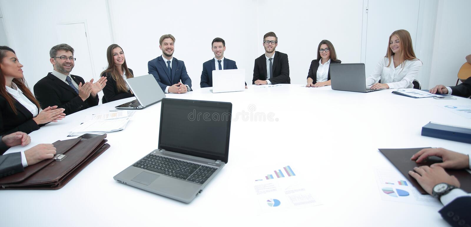 Meeting of shareholders of the company at the round - table. stock photos