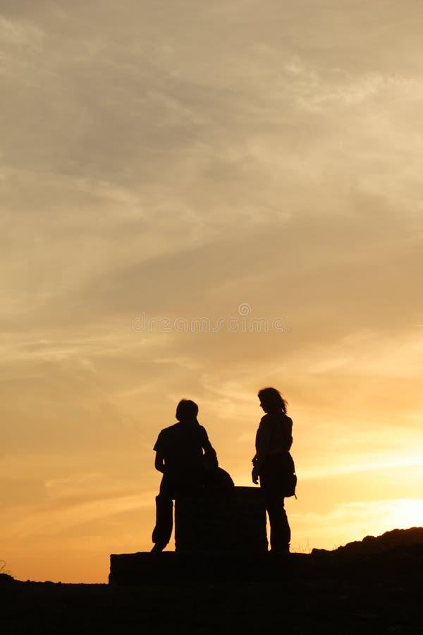 Meeting at sunset stock photos