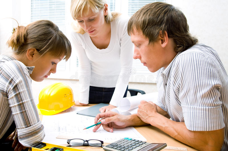 Meeting the team of engineers. Working on a construction project at the table royalty free stock photos