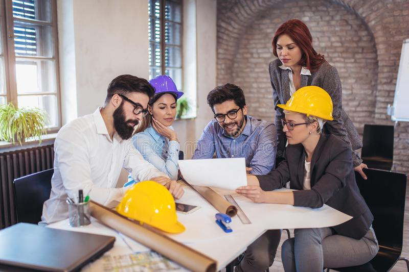 Meeting the team of engineers working on a construction project royalty free stock photos