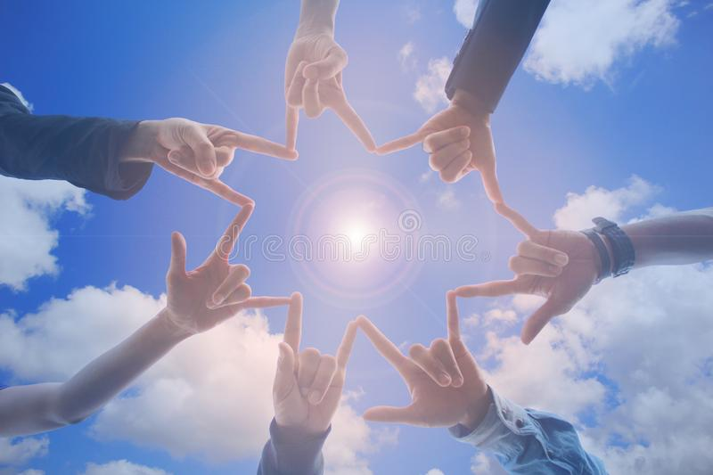 Meeting teamwork concept, Friendship group with hands showing unity on blue sky background, Symbol for love stock images