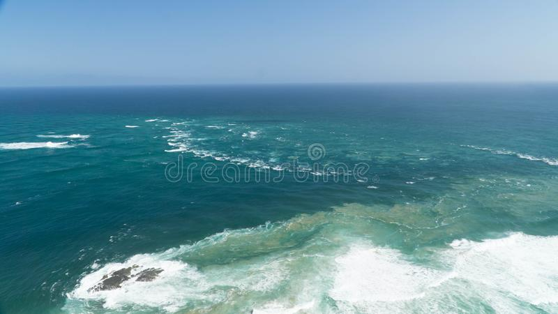 The meeting of two bodies of water - the Tasman Sea and the Pacific Ocean, New Zealand. The meeting of two bodies of water - the Tasman Sea and the Pacific Ocean royalty free stock photo