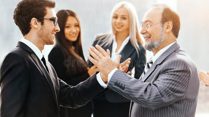 Meeting of two business partners, a second before  friendly hand royalty free stock images