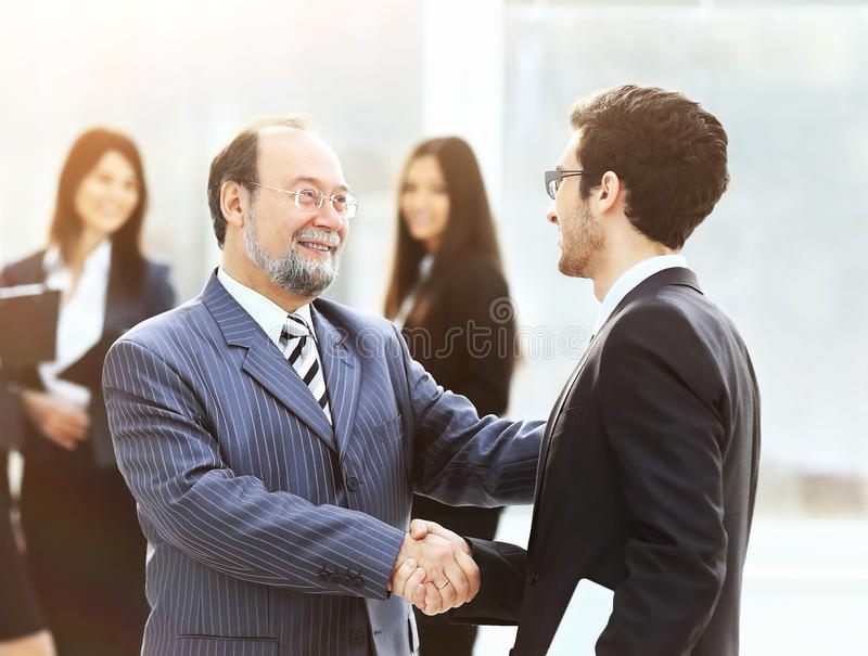 Meeting of two business partners are shaking hands at a presentation royalty free stock photo