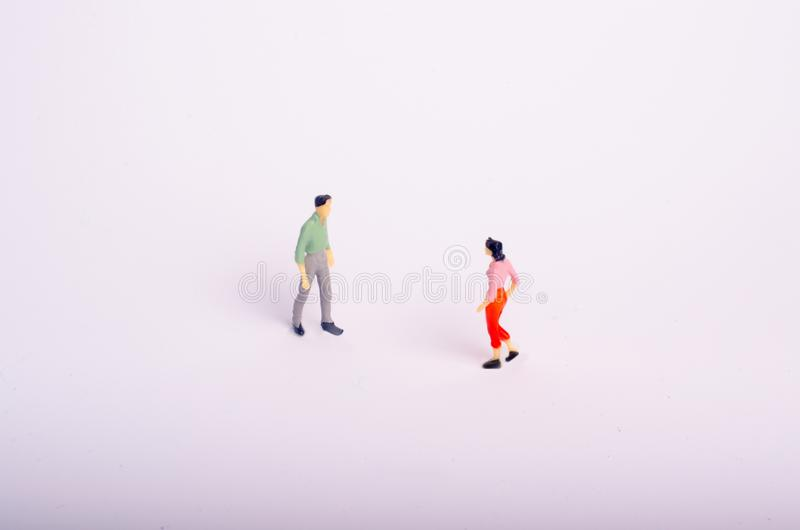 Meeting of two people on a white background. A man and a woman go to meet each other. Romantic relationship, love meeting, busines. S meeting. Important stock image