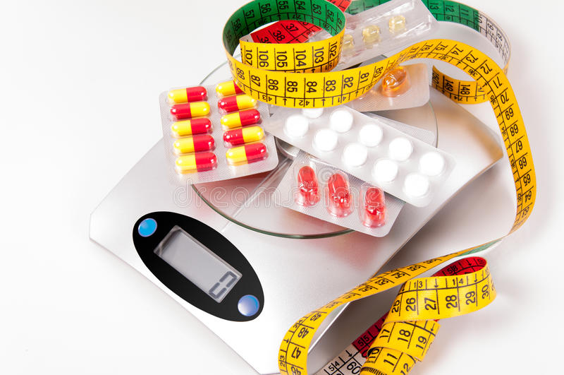 Meetlint en geneesmiddel stock fotografie