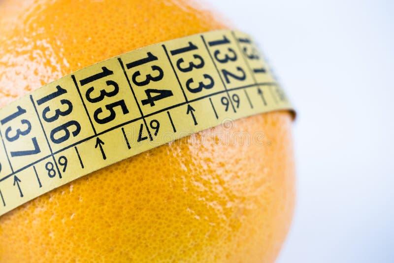 Meetlint op sinaasappel stock foto's