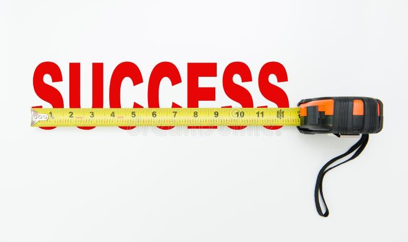 Maatregel van succes stock foto
