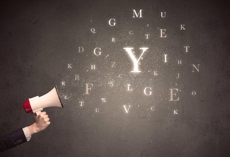 Megáfono con las letras foto de archivo
