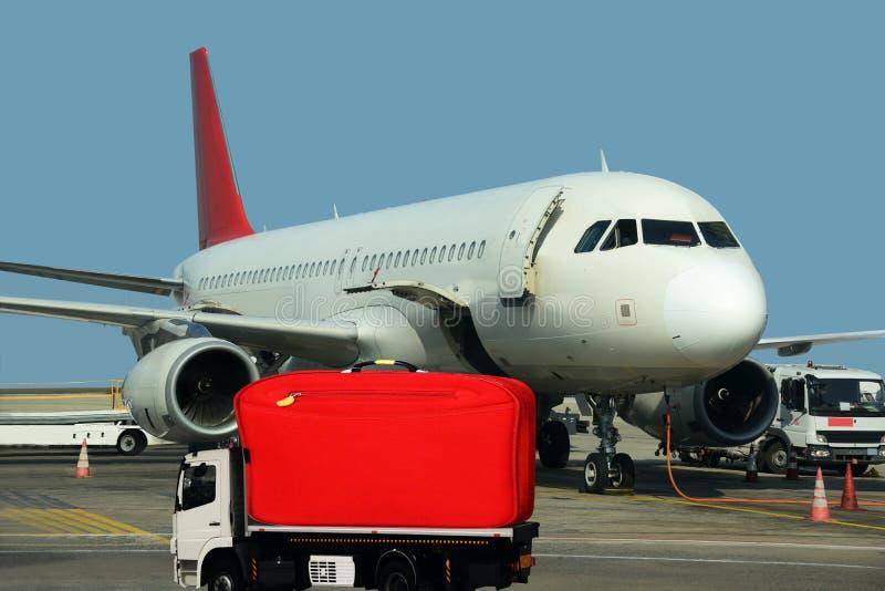 Mega bag on track. Plane loading. Cargo concept royalty free stock photos