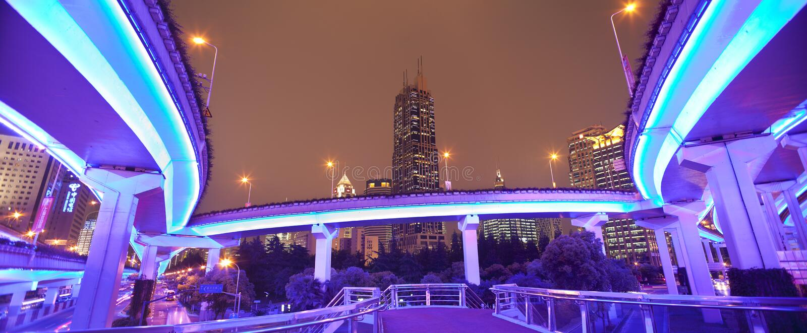 Mega city Shanghai. Shanghai/China: Mega city Shanghai, traffic and pedestrian bridges at night stock photography