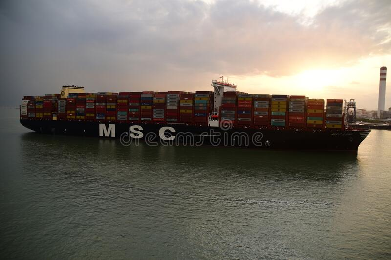 Mega container vessel arriving to the port stock photo