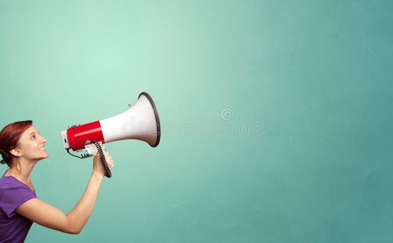 Megafono della tenuta della persona fotografia stock libera da diritti