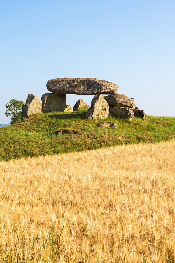 Megalith grave on a hill. In the countryside stock image