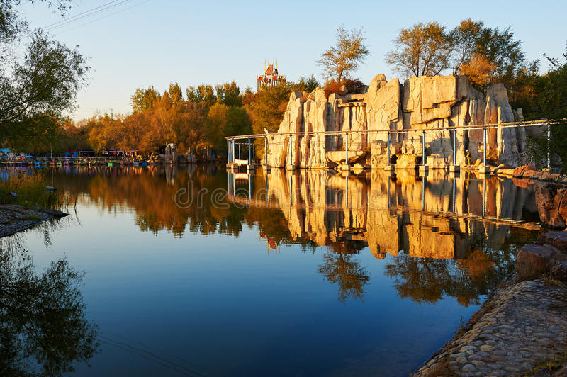 The megalith in the lakeside. The photo was taken in Youtian Leyuan park Daqing city Heilongjiang province, China stock images