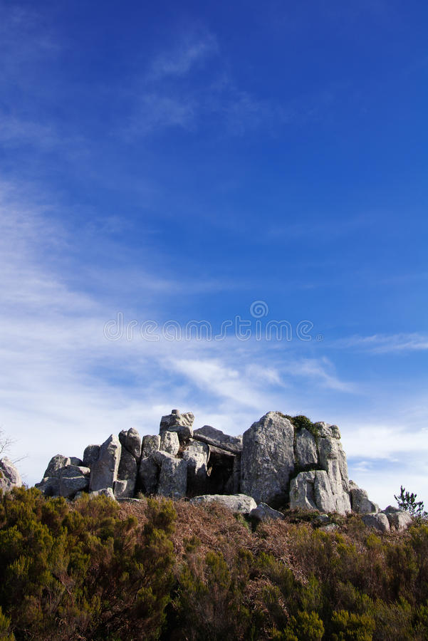 Megalith stones. Megalith monument stones under a blue clouded sky. Vertical version. Sintra, Portugal stock image
