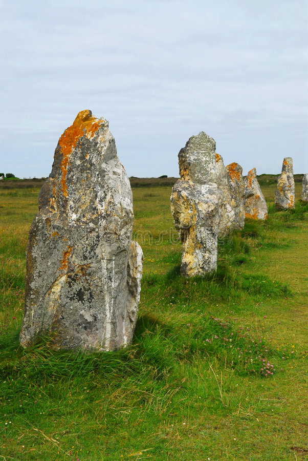 Megalithic monuments in Brittany. Row of prehistoric megalithic monuments menhirs in Brittany, France stock photo